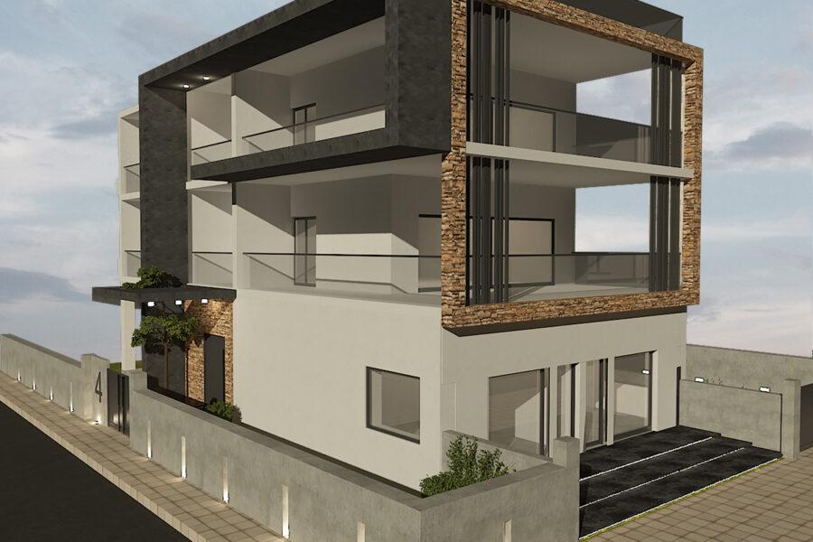 Νέα διώροφη πολυκατοικία με υπόγειο, πυλωτή και καταστήματα ισογείου